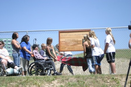 unveiling of sign, dedicating field to Harley Hopkins